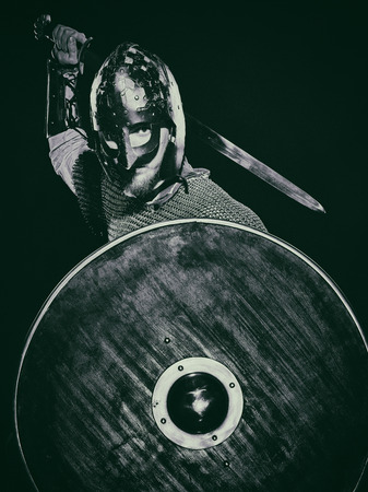 shields: Medieval knight armor with a sword, helmet and shield, black and white image