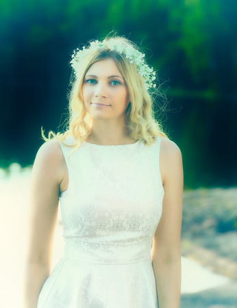 cross processed: Portrait, attractive blond woman wearing a flower head wreath, summer day, cross processed image Stock Photo