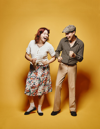 70s: Couple and 70s look theme, yellow background