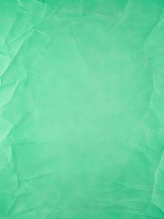 arrugas: tipo de papel viejo verde, pliegues y arrugas. Foto de archivo