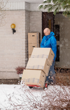 wheel house: People moving house, man using the 2 wheel dolly
