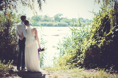 aciculum: The bride and groom standing by  the river