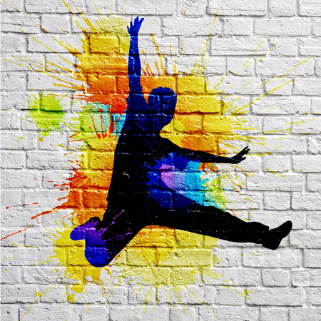 graffiti jumping man on a brick wall