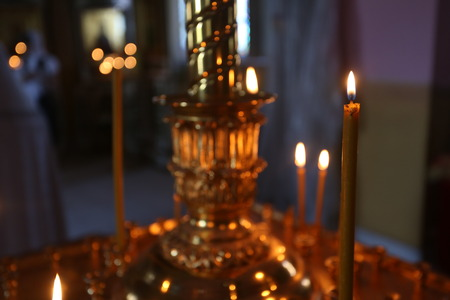 easter candle is burning: A little burning Church candles against a dark background, closeup Stock Photo