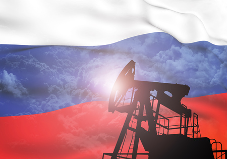 Oil pump on background of flag of Russia