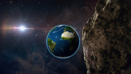 asteroid or meteor flies through space to earth