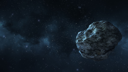 an asteroid or a meteorite flies in space, against the background of nebulae Imagens