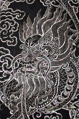 Traditional Thai style church door art with chiness dragon photo