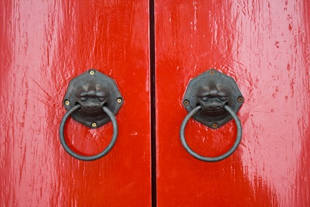 lion knocker on Tradtional asian  red door photo