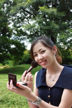 beauty shot: Beauty shot, young woman doing makeup