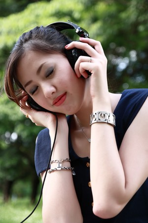 Pretty young girl listening music Stock Photo - 7889604