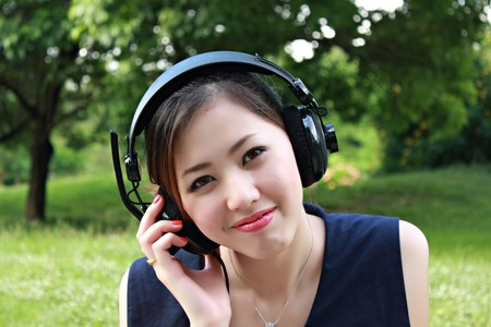 Pretty young girl listening music photo