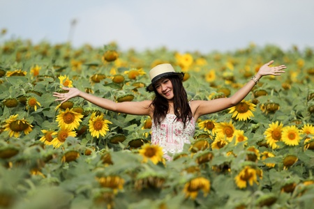 portrait of a happy young girl in a sunflower field photo