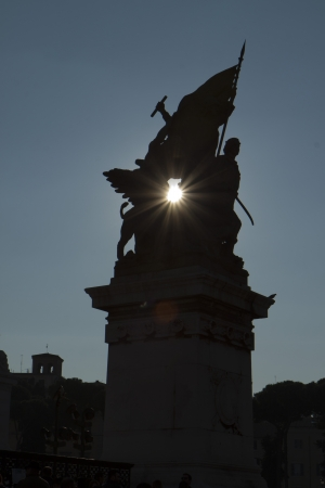 Statue and sun in Roma photo