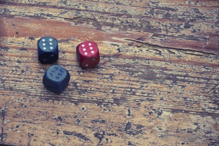 vintage three dices with triple six on the wood floor photo