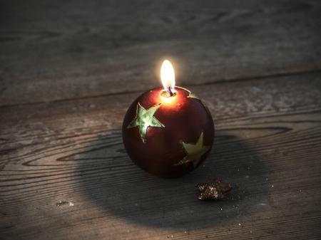 beautiful christmas decoration candle - on the wooden floor photo