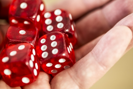 five red dice in the hand - six, one, three Stock Photo