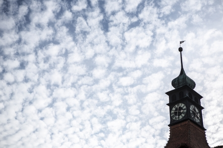 tower of church with clock nad clouds  photo