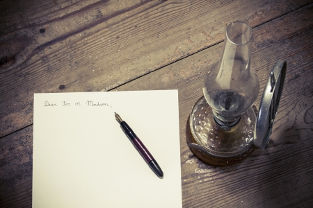 Old fashioned letter with a pen and lamp photo