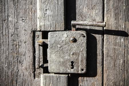 Black old door handle on the wooden doors photo