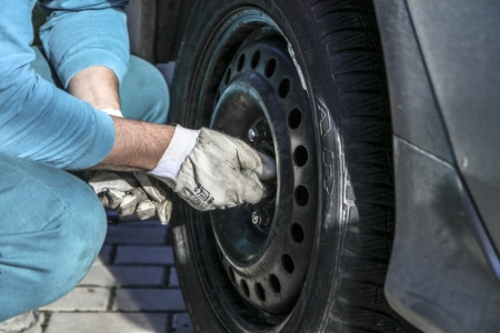Changing tires or wheel before winter or spring photo