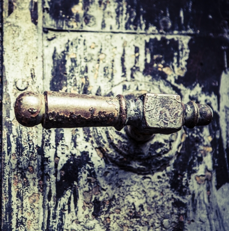 Beautiful old black door handle from castle photo