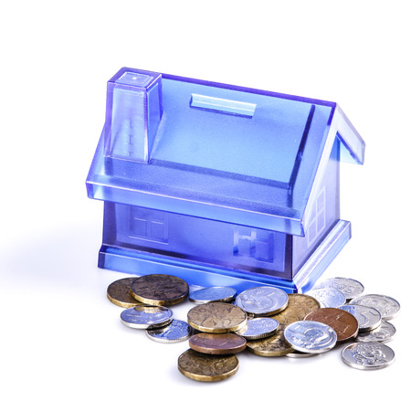 Blue House Money Box on White Background with coins photo