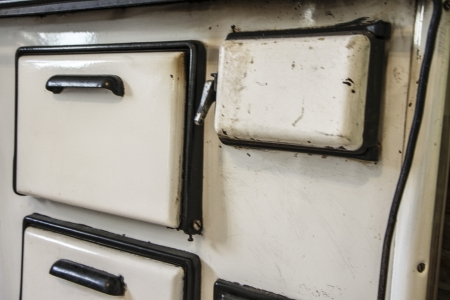 bakeoven: Old white metal oven in the kitchen