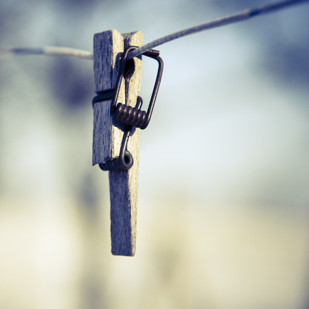 Broken clothespin on the wire, focus on the foreground photo