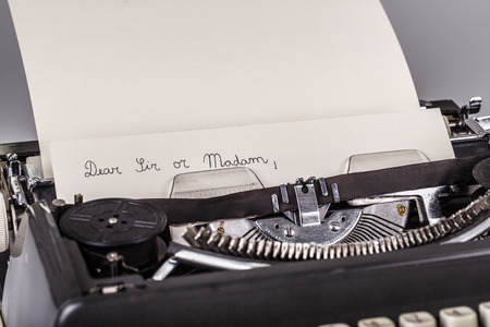 madam: paper in typewriter with Dear Sir or Madam as text