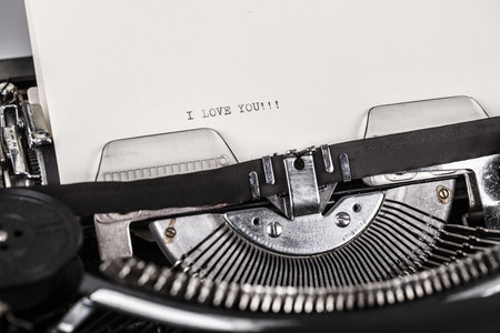 key words art: paper in typewriter with I Love You!!! as a text