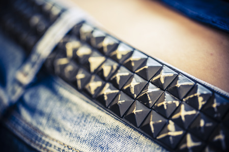 belt of metal studs or pyramid on the woman