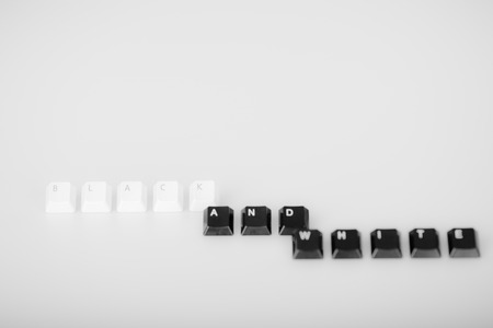 Words black and white formed with computer keyboard keys on white background with shadow photo
