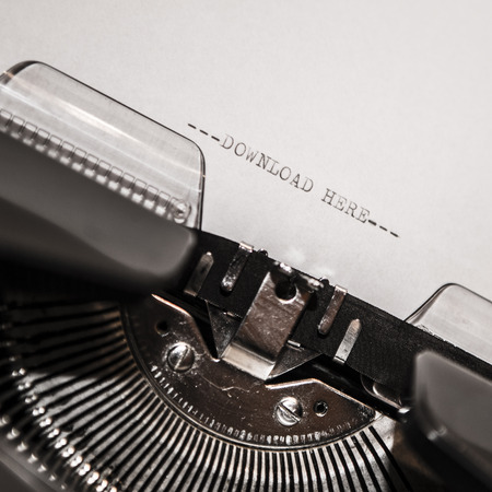 Typewriter closeup shot, concept of download photo