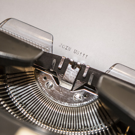 Typewriter closeup shot, concept of join us photo