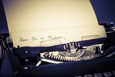 paper in typewriter with Dear Sir or Madam as text Stock Photo