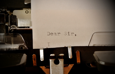 Letter with a title Dear Sir typed on old typewriter photo
