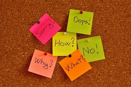 Notice cork board with many sticky note pads photo