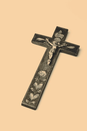 Beautiful old wooden cross with Jesus on white background photo