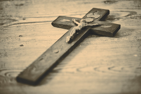 wooden cross: Beautiful old cross with jesus on the old wooden floor