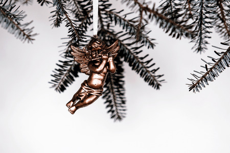 christmas decoration - golden angel on green branch photo