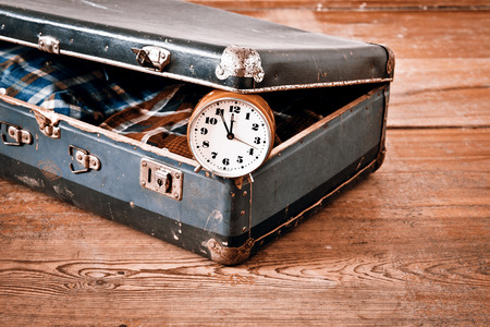 open suitcase: Old suitcase with old alarm clock and old shirt Stock Photo