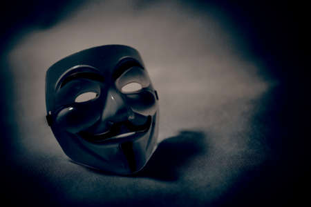 vendetta: white anonymous mask on white background Stock Photo