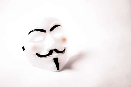 vendetta: white anonymous mask on white background Stock Photo