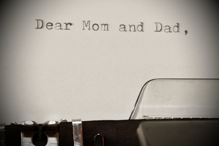 dear: Letter with a title Dear Mom and Dad typed on old typewriter