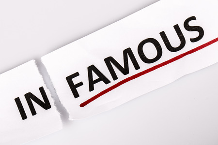 infamous: The word infamous changed to famous on torn paper and white
