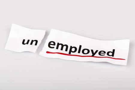 changed: The word unemployed changed to employed on torn paper and white background