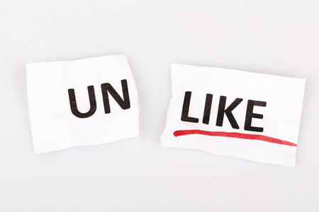 changed: The word unlike changed to like on torn paper and white background