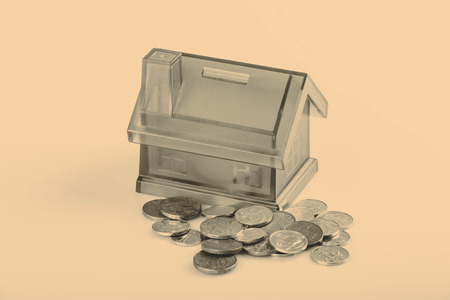 czech republic coin: Blue House Money Box on White Background with coins