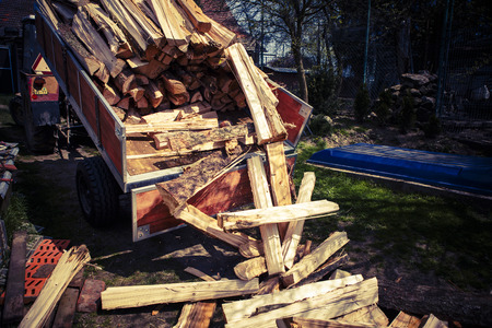 logging truck: logging tractor on the back yard - wood for fire